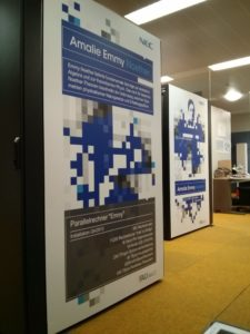 sideview of serverracks in the serverroom, with posters about Emmy Noether