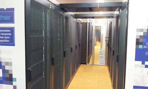 Aisle in the serverroom with racks full of servers on both sides